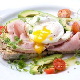 Poached Eggs with Ham and Cheese Sauce
