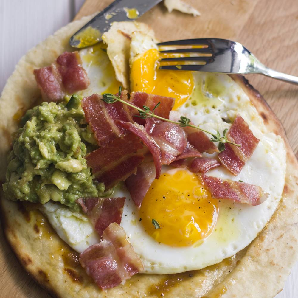 Naan Bread Topped with Fried Eggs and Accompaniments