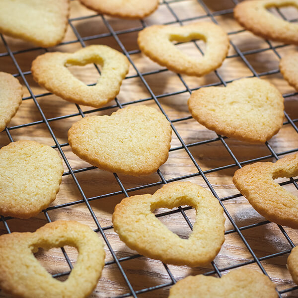 When baked, cut half of the cookies with a small heart shaped cutter